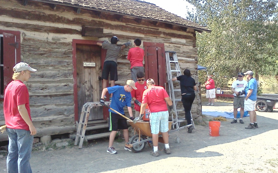Eagle Scouts maintain historic cabins at history park