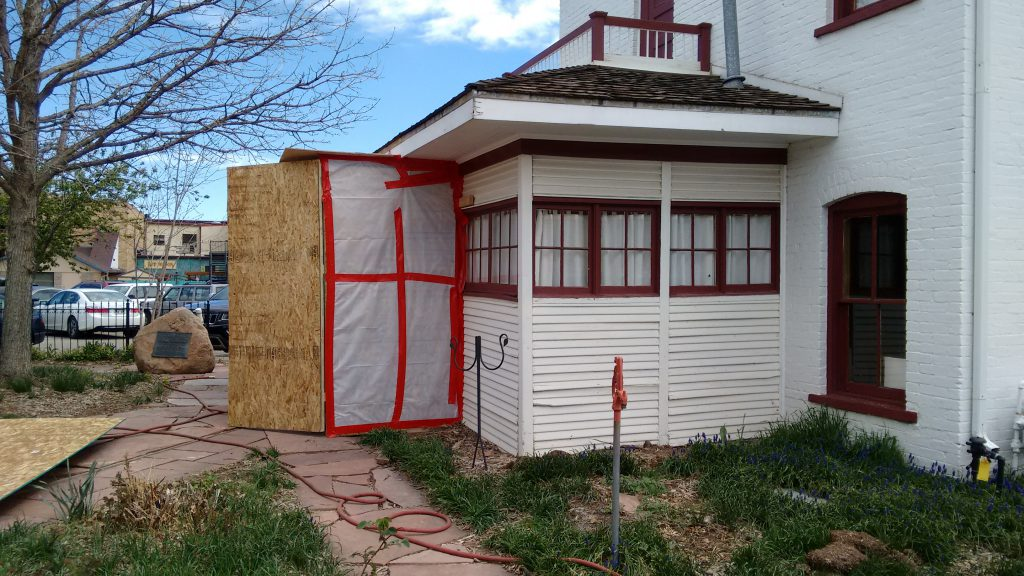 A temporary airlock has been added to the back door of Astor House