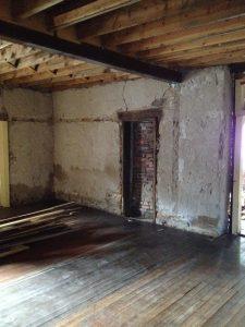 Hidden door to exterior exposed on northwest corner of parlor.