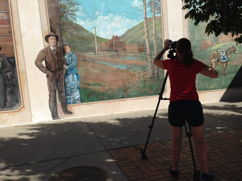 Filming the Robert Dafford mural on the Foss Building in downtown Golden
