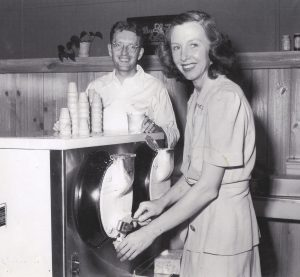 Bill and Dorothy Harmsen serving ice cream at their very first store in Golden, Colorado.